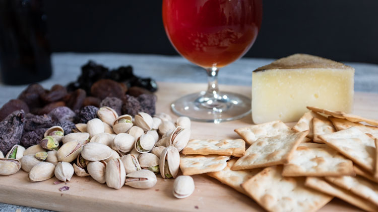 Fruit and nuts with a belgian beer