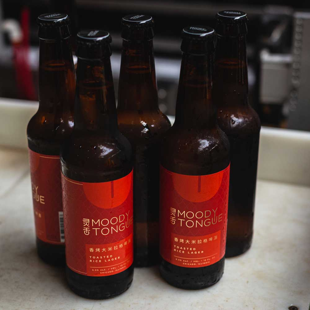 moody tongue's toasted rice lager bottles